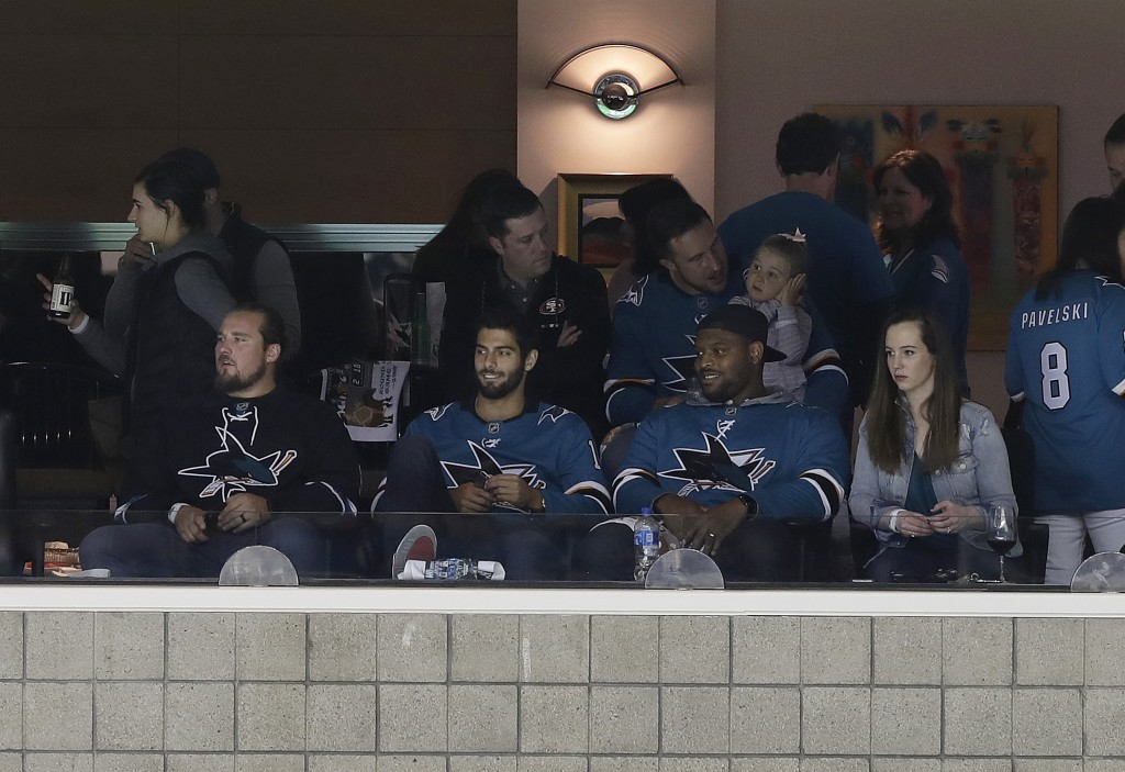 San Francisco 49ers quarterback Jimmy Garoppolo, bottom center, watches Game 3 of an NHL hockey second-round playoff series between the San Jose Shark...