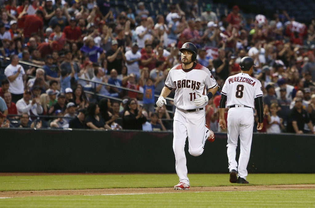 Arizona Diamondbacks' A.J. Pollock (11) rounds the bases after celebrating his home run against the Los Angeles Dodgers with third base coach Tony Per...
