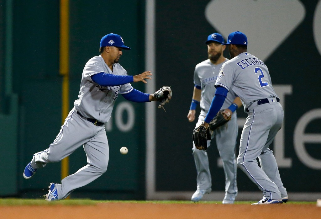 Kansas City Royals' Cheslor Cuthbert drops the ball on an error beside teammates Alex Gordon, center, and Alcides Escobar (2) that allowed Boston Red ...