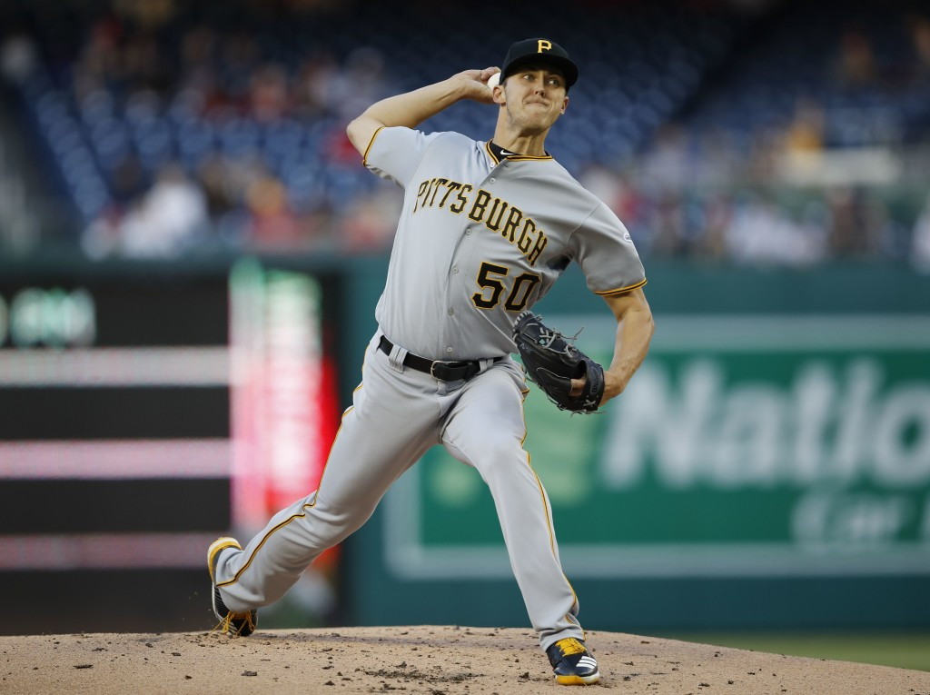 Pittsburgh Pirates starting pitcher Jameson Taillon (50) delivers a pitch against the Washington Nationals, during the first inning of a baseball game...