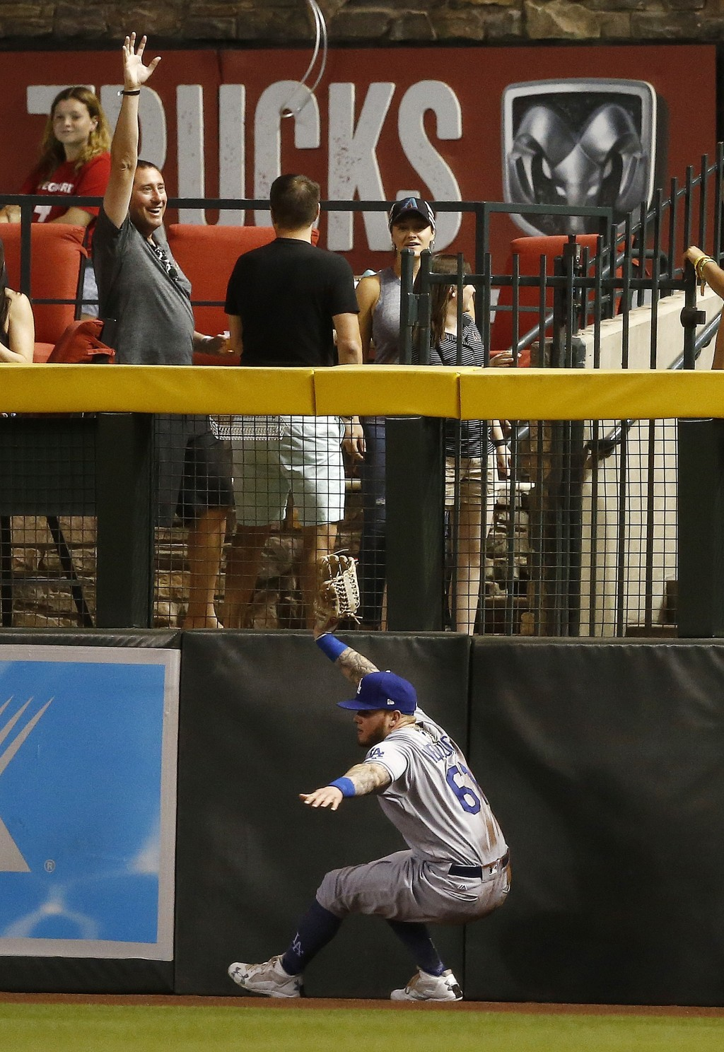 Los Angeles Dodgers right fielder Alex Verdugo is unable to make a catch on a ground rule double hit by Arizona Diamondbacks' Zack Greinke during the ...