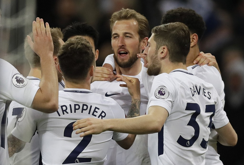 Tottenham's Harry Kane, centre, celebrates scoring his side's second goal during the English Premier League soccer match between Tottenham Hotspur and...