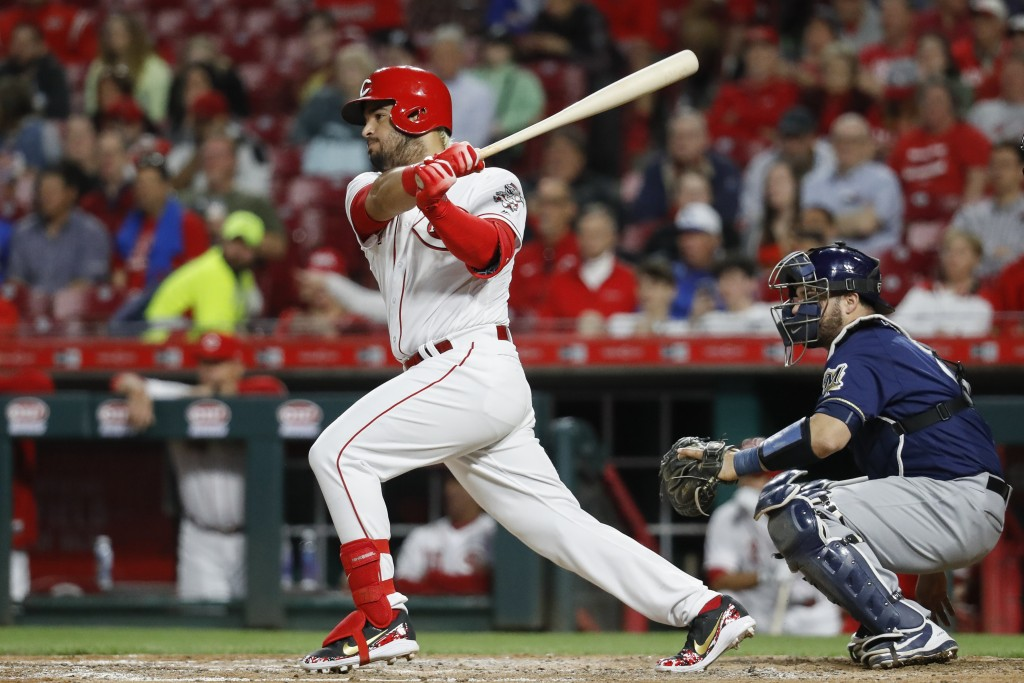 Cincinnati Reds' Eugenio Suarez hits a two-run single off Milwaukee Brewers relief pitcher Jacob Barnes in the fifth inning of a baseball game, Monday...