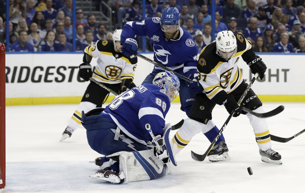 Tampa Bay Lightning goaltender Andrei Vasilevskiy (88) stops a shot by Boston Bruins center Patrice Bergeron (37) during the first period of Game 2 of...