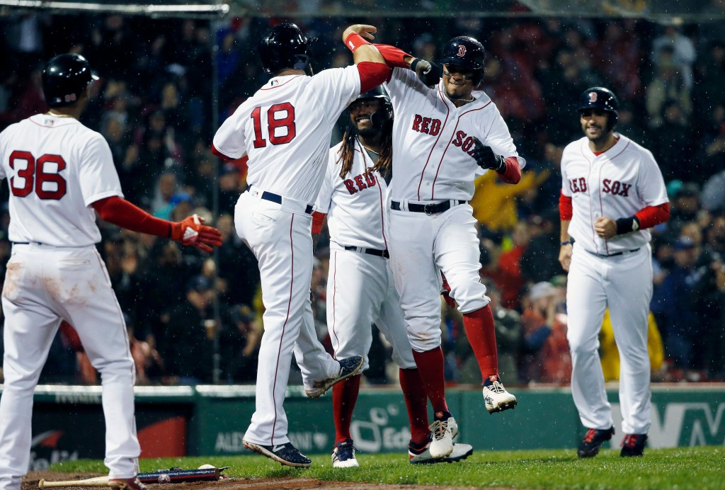 Boston Red Sox's Xander Bogaerts, center right, celebrates his grand slam that also drove in Mitch Moreland (18), Hanley Ramirez, behind and J.D. Mart...