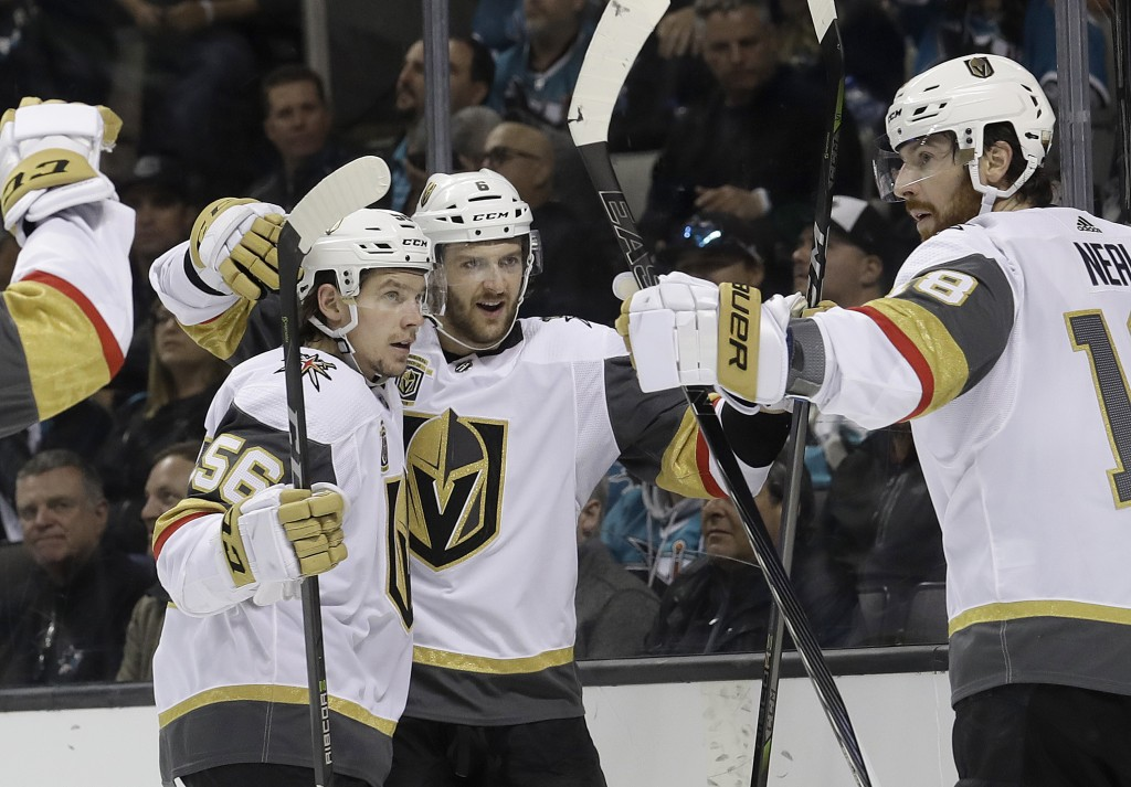 Vegas Golden Knights defenseman Colin Miller, center, is congratulated by teammates after scoring a goal against the San Jose Sharks during the second...
