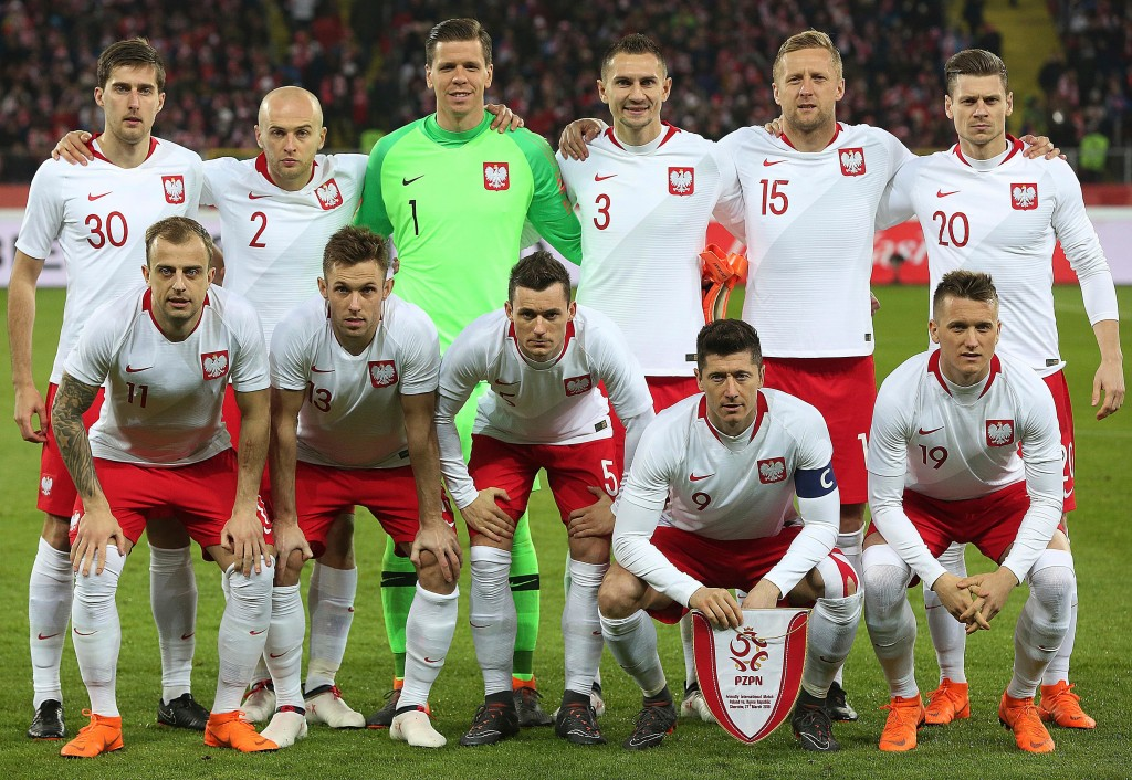 In this photo taken on Tuesday, March 27, 2018, Poland team pose before an international friendly soccer match between Poland and South Korea in Chorz...