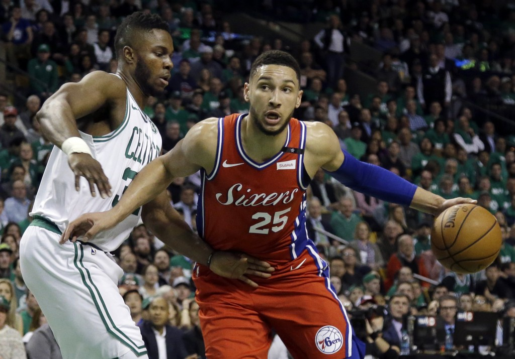 Philadelphia 76ers guard Ben Simmons (25) drives against Boston Celtics forward Semi Ojeleye (37) in the first quarter of Game 1 of an NBA basketball ...