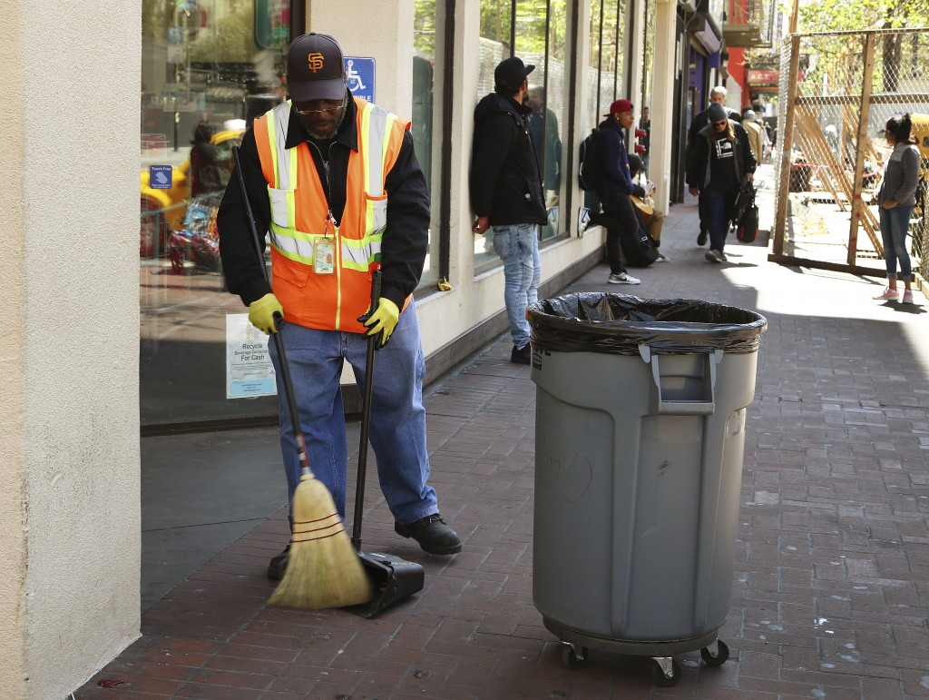 In this photo taken on Thursday, April 26, 2018, a city sanitation worker sweeps Market Street in San Francisco. San Francisco may have hit peak satur...