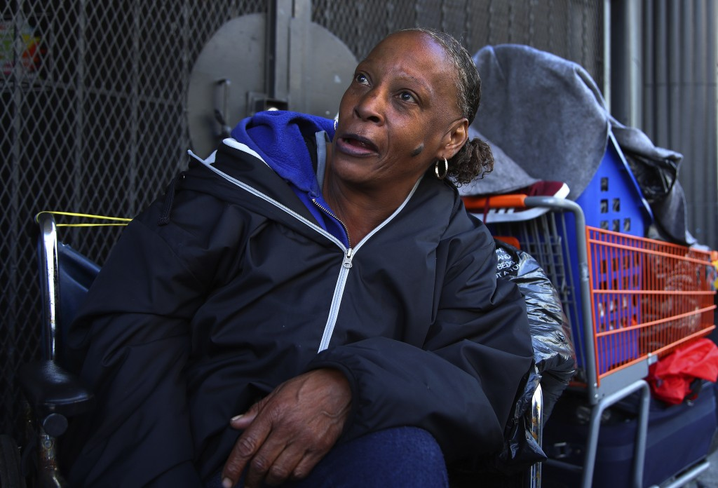 In this photo taken on Thursday, April 26, 2018, Lawana Tillman sits in a wheelchair with her belongings in San Francisco. Tillman camps out in a whee...