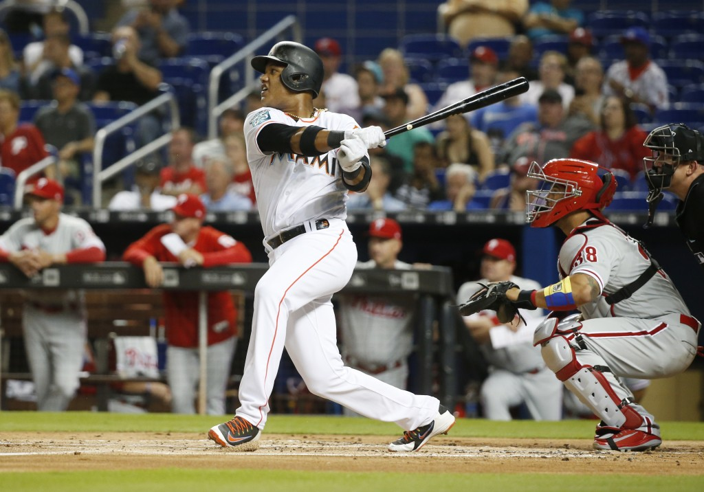 Miami Marlins' Starlin Castro hits a double during the first inning of a baseball game against the Philadelphia Phillies, Monday, April 30, 2018, in M...