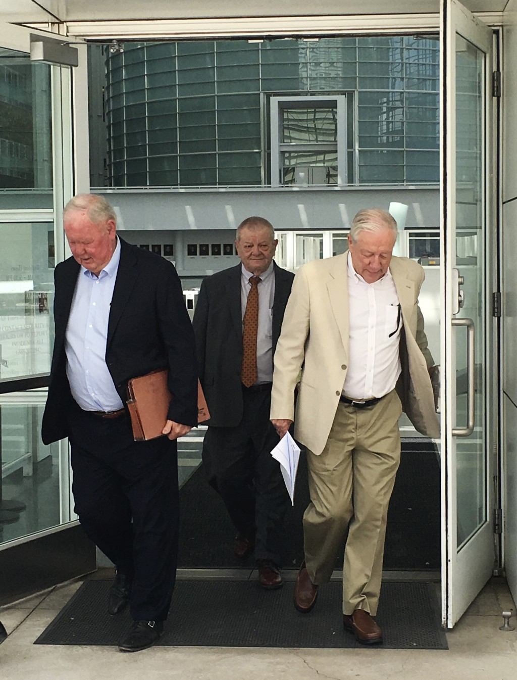 Backpage.com founders James Larkin, left, and Michael Lacey, right, leave U.S. District Court in downtown Phoenix on Monday, April 30, 2018. A judge s...