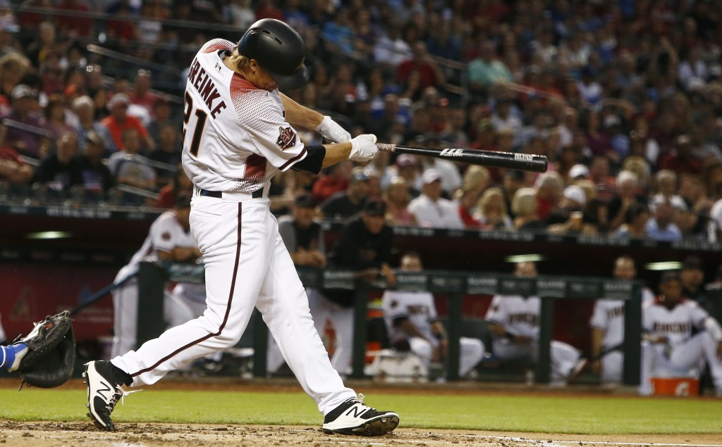 Arizona Diamondbacks' Zack Greinke connects for a run-scoring single against the Los Angeles Dodgers during the second inning of a baseball game Monda...