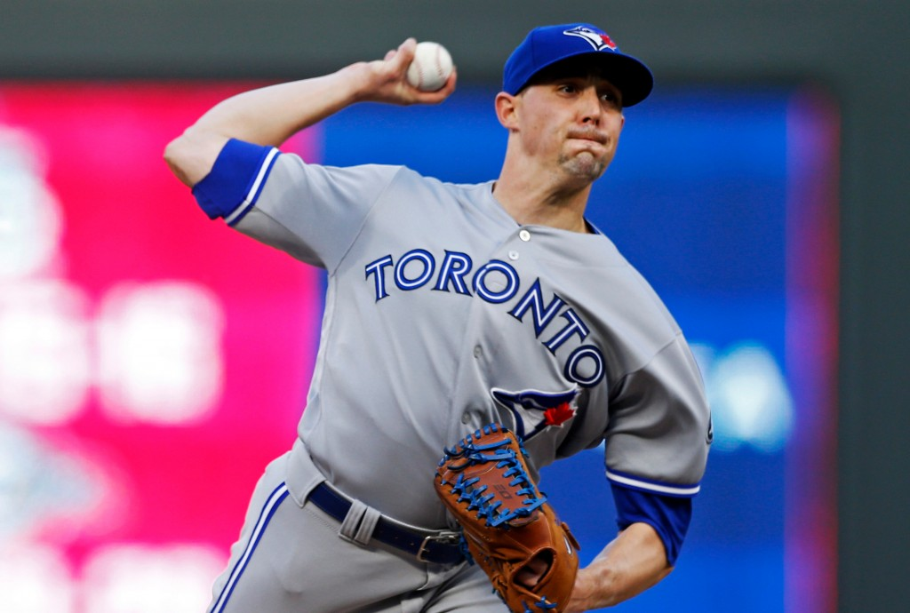 Toronto Blue Jays' pitcher Aaron Sanchez throws against the Minnesota Twins in the first inning of a baseball game Monday, April 30, 2018, in Minneapo...