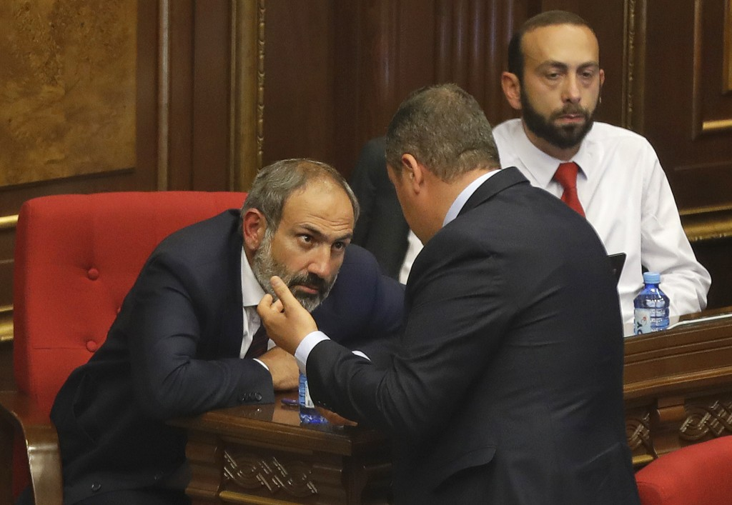 Opposition lawmaker Nikol Pashinian, left, consults with a colleague after speaking during a parliament session to choose a replacement of Prime Minis...
