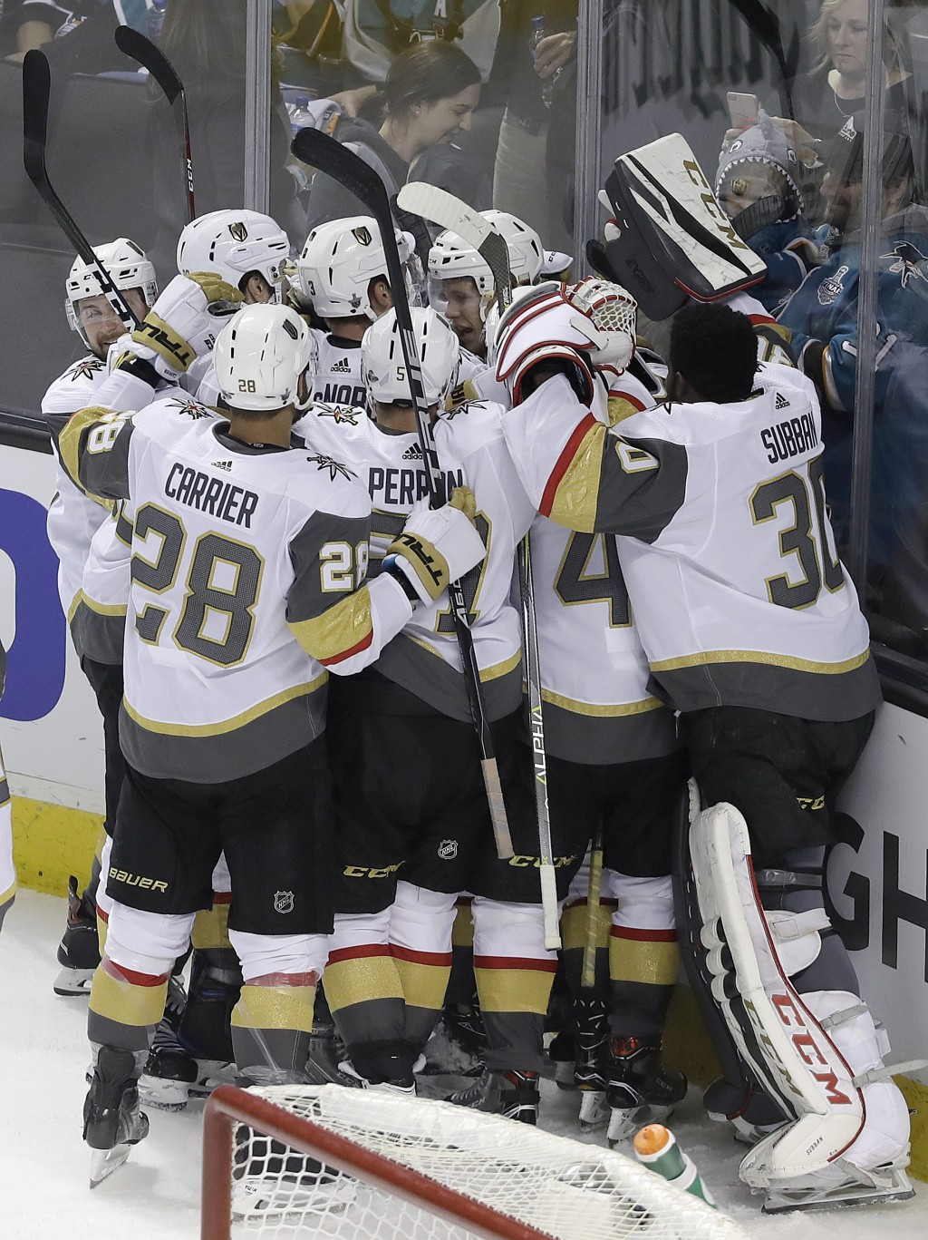 Vegas Golden Knights players celebrate after center William Karlsson, from Sweden, scored the winning goal against the San Jose Sharks during overtime...