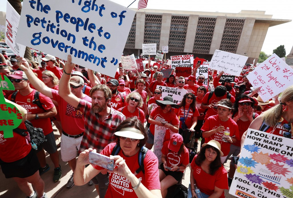 Teachers rally outside the Capitol on Monday, April 30, 2018, in Phoenix on their third day of walk outs. Teachers in Arizona and Colorado walked out ...
