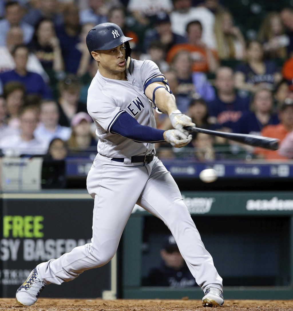 New York Yankees' right fielder Giancarlo Stanton (27) strikes out during the ninth inning of a baseball game against the Houston Astros Monday, April...