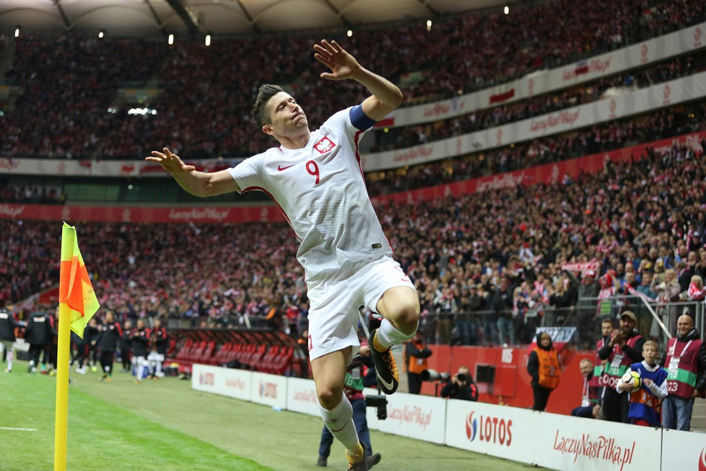 In this photo taken on Sunday, Oct. 8, 2017, Poland's Robert Lewandowski celebrates after he scored a goal during the World Cup Group E qualifying soc...