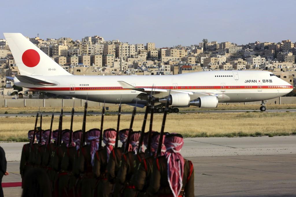The Japanese Prime Minister Shinzo Abe's plane seen arrives at Amman Airport in Amman, Jordan, Monday, April 30, 2018. (AP Photo/Raad Adayleh)