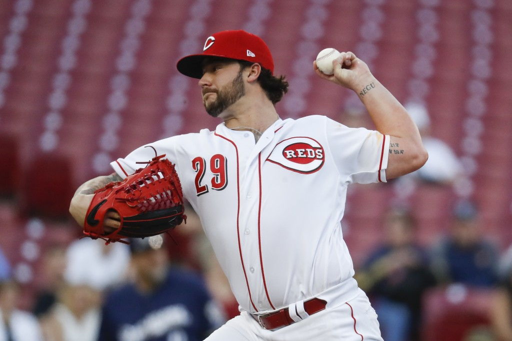 Cincinnati Reds starting pitcher Brandon Finnegan throws in the first inning of a baseball game against the Milwaukee Brewers, Monday, April 30, 2018,...