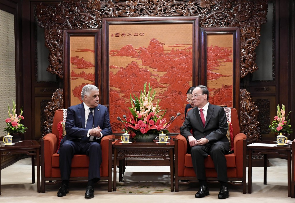 Chinese Vice President Wang Qishan, right, and Dominican Republic's Foreign Minister Miguel Vargas, left, hold a meeting at the Zhongnanhai Leadership...