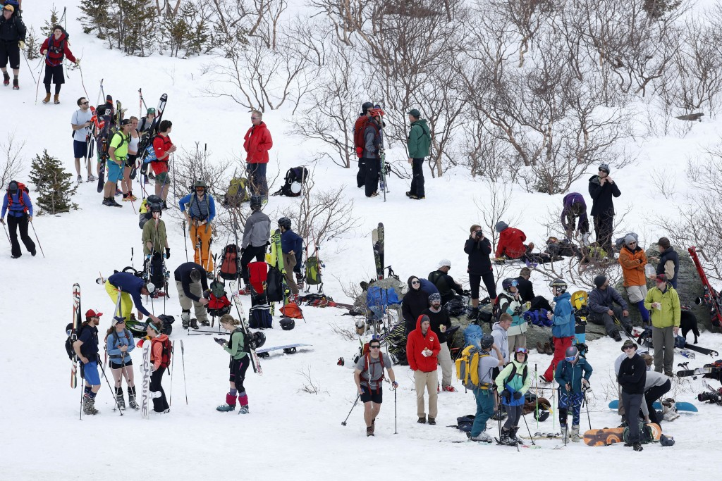 FILE - In this May 5, 2015, file photo, skiers gather in the bowl of Tuckerman Ravine on New Hampshire's Mount Washington. With the increase in the po...