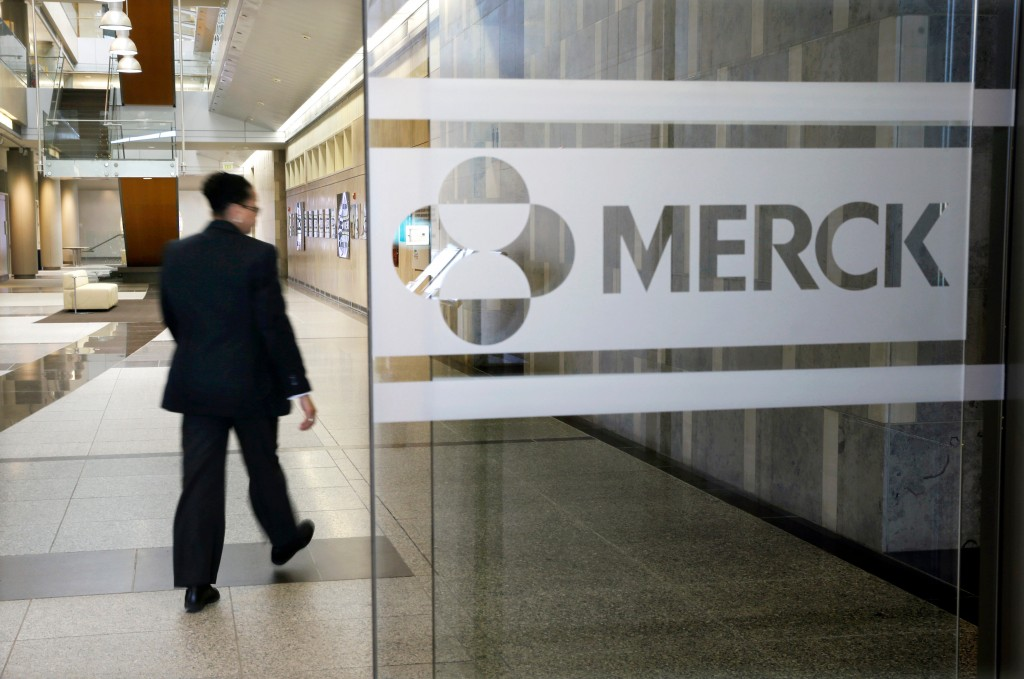 FILE - In this Dec. 18, 2014, file photo, a person walks through a Merck company building, in Kenilworth, N.J. Merck & Co. reports earnings Tuesday, M...