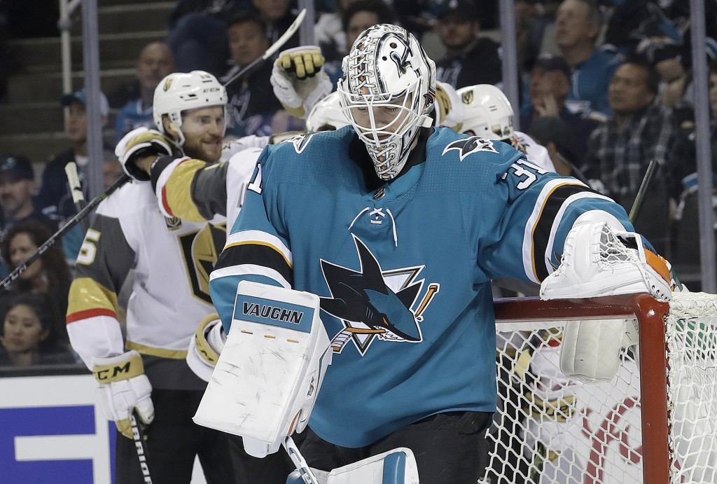 San Jose Sharks goalie Martin Jones (31) reacts as Vegas Golden Knights players celebrate a goal by Reilly Smith during the second period of Game 3 of...