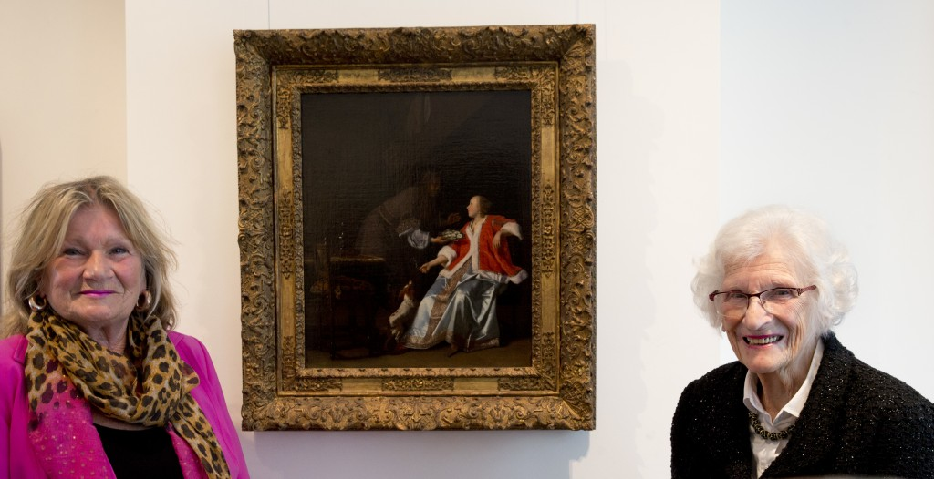"""Ninety-seven-year-old Charlotte Bischoff van Heemskerck, right, and her daughter Rudolphine pose next to the painting """"The Oyster Meal"""" by Jacob Ochte..."""
