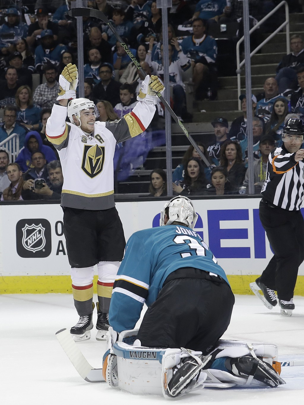 Vegas Golden Knights right wing Reilly Smith, top, celebrates after scoring a goal as San Jose Sharks goalie Martin Jones, bottom, reacts during the s...