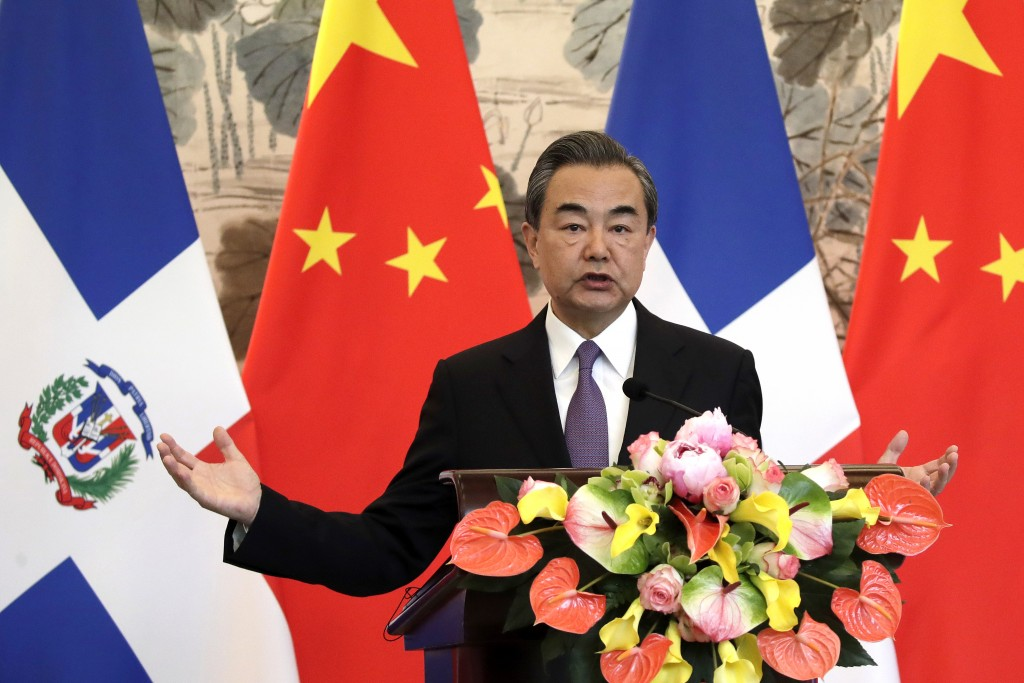 Chinese Foreign Minister Wang Yi speaks during a press briefing with Dominican Foreign Minister Miguel Vargas after they signed the joint communique a...