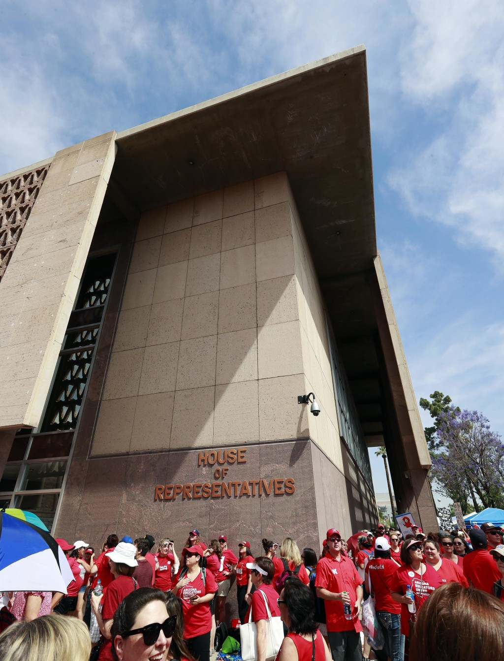 Teachers rally outside the Arizona House of Representatives Monday, April 30, 2018, in Phoenix on their third day of walk outs. Teachers in Arizona an...