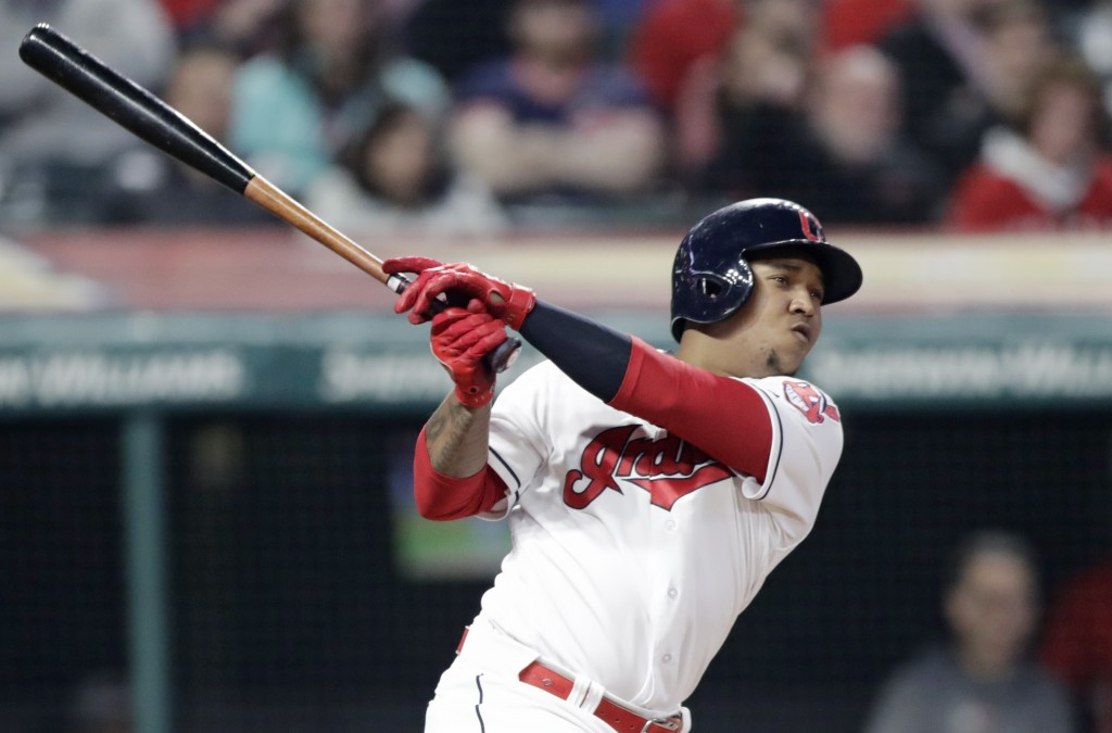 Cleveland Indians' Jose Ramirez hits a one-run double in the eighth inning of a baseball game against the Texas Rangers, Monday, April 30, 2018, in Cl...