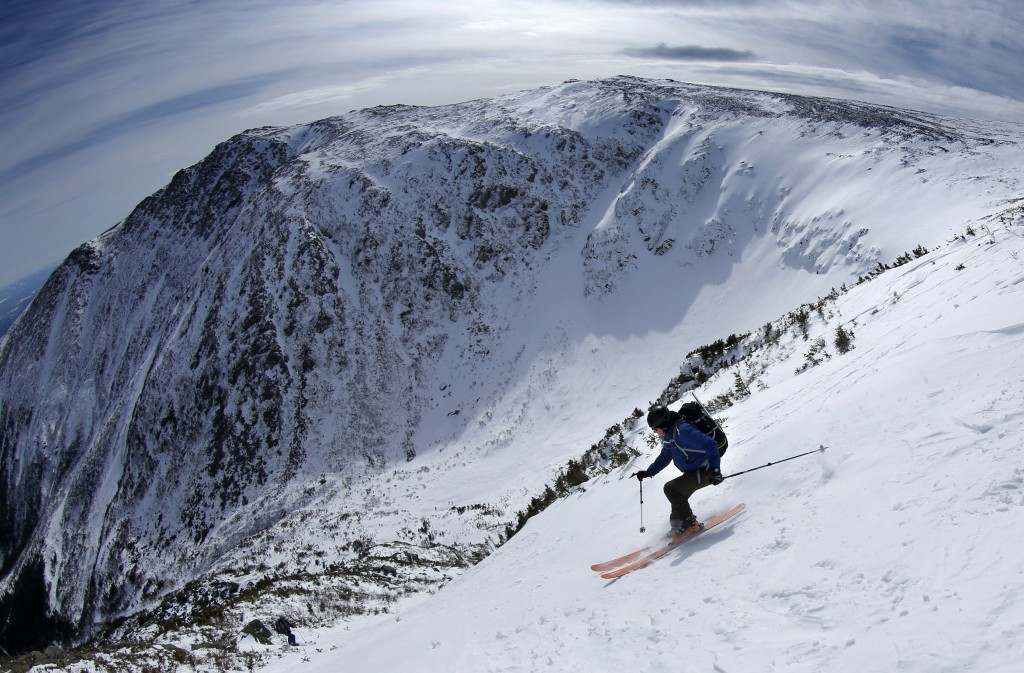 FILE - In this March 10, 2015, file photo, Greg George, of Macon, Ga., skis the Lobster Claw, a steep ski route in Tuckerman Ravine on New Hampshire's...