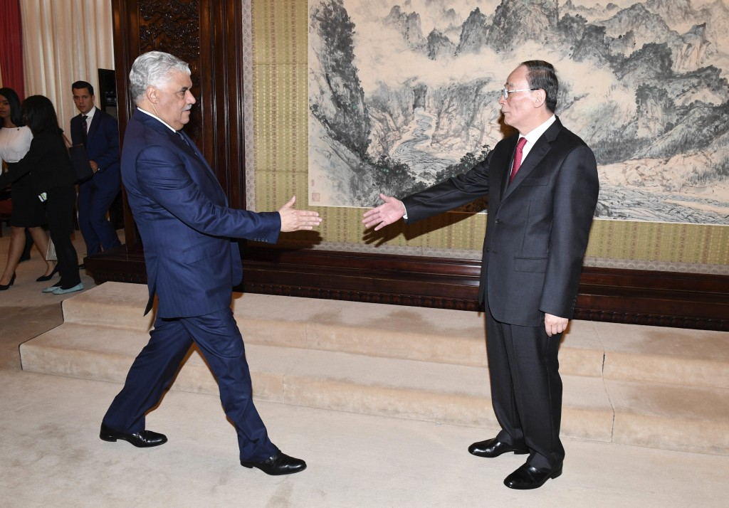 Chinese Vice President Wang Qishan, right, and Dominican Republic's Foreign Minister Miguel Vargas during a meeting at the Zhongnanhai Leadership Comp...