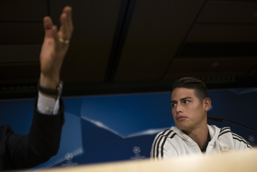 Bayern Munich's James Rodriguez talks to journalists during a news conference at the Santiago Bernabeu stadium in Madrid, Monday, April 30, 2018. Baye...