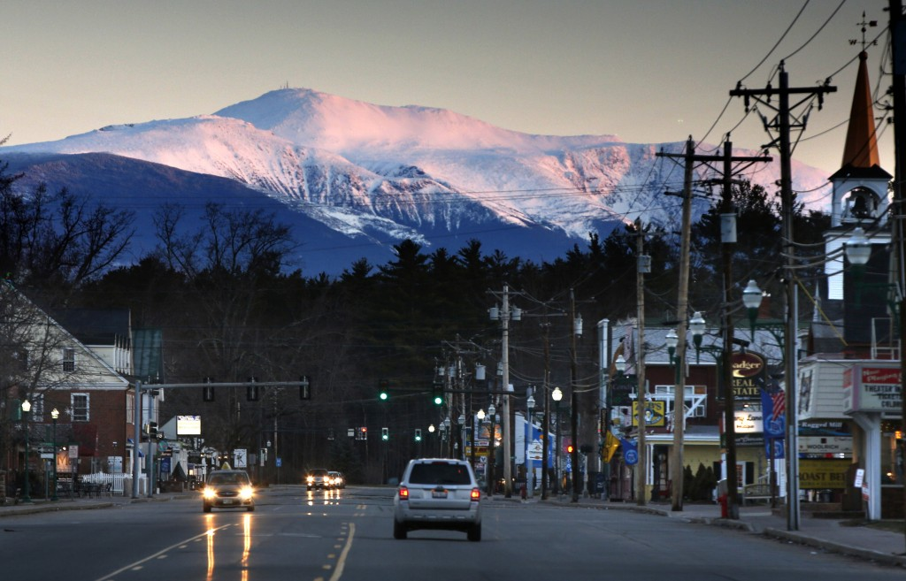 In this Monday, April 23, 2018, photo, the snow-covered slopes of Mount Washington catch the first light of dawn about 18 miles north of North Conway,...