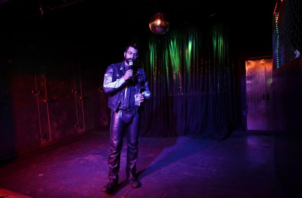 In this Monday, April 30, 2018 photo, a patron sings during karaoke night at The SF Eagle, a historic gay bar, in San Francisco. San Francisco's gay a...