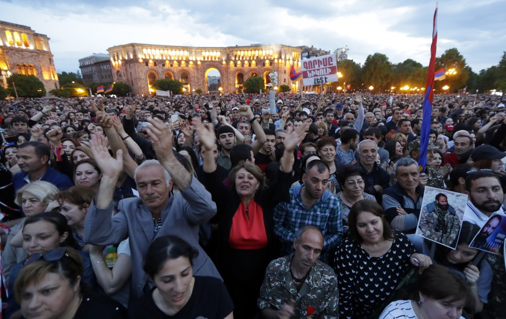 Poeple gather during a rally in Yerevan on Monday, April 30, 2018. Armenia's parliament plans to choose a replacement on Tuesday for Serzh Sargsyan, w...