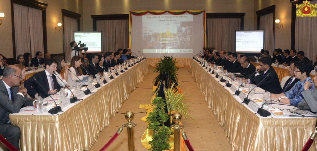 In this April 30, 2018, image provided by Myanmar's State Counsellor Office, ambassadors from the U.N. Security Council, left, and Myanmar's Governmen...