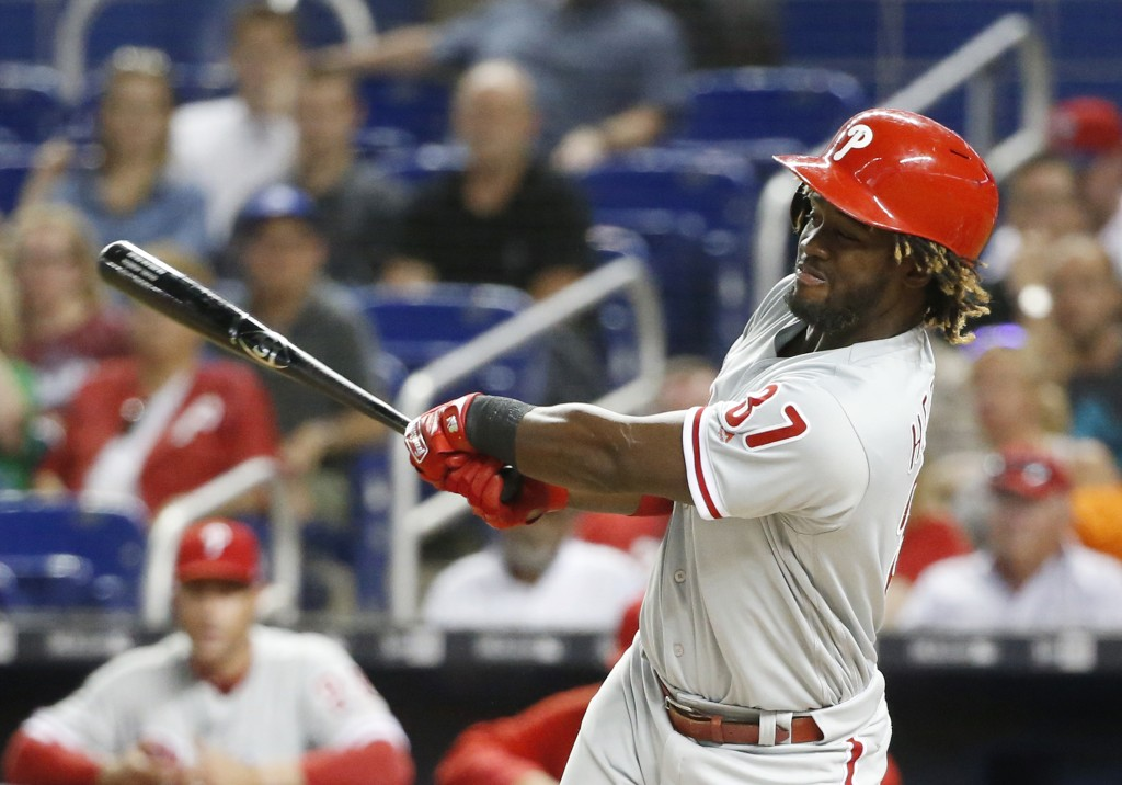Philadelphia Phillies' Odubel Herrera hits a single during the first inning of a baseball game against the Miami Marlins, Monday, April 30, 2018, in M...