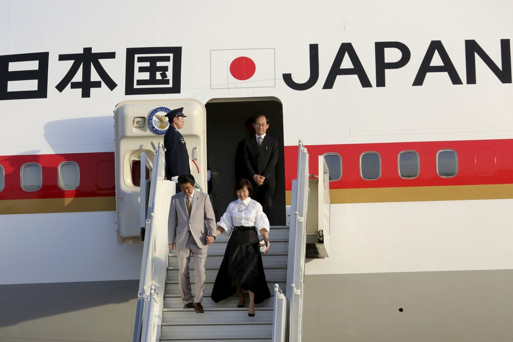 Japanese Prime Minister Shinzo Abe and his wife Akie Abe disembark their plane at Amman military airport, in Amman, Jordan, Monday, April 30, 2018. (A...