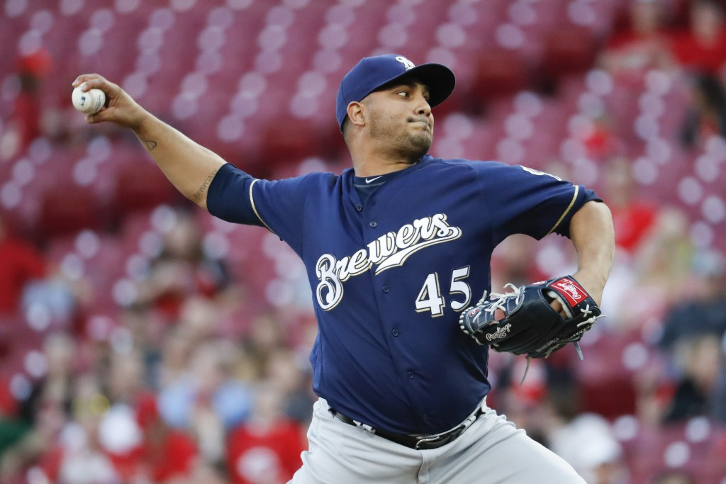 Milwaukee Brewers starting pitcher Jhoulys Chacin throws in the first inning of a baseball game against the Cincinnati Reds, Monday, April 30, 2018, i...