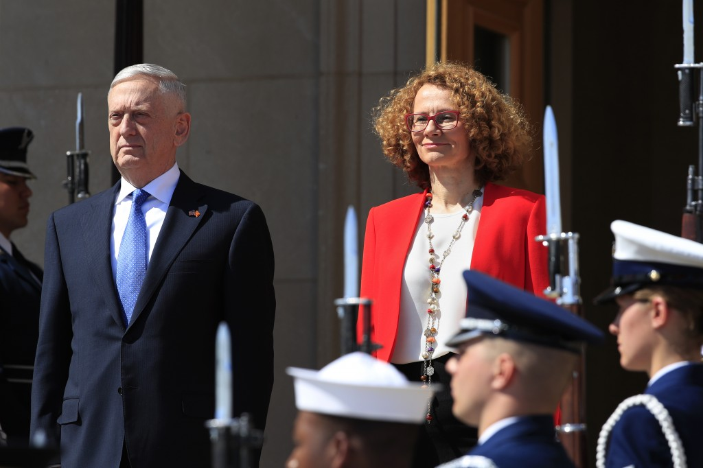 Secretary of Defense Jim Mattis and Macedonian Defense Minister Radmila Sekerinska, right, stand at attention during a ceremony welcoming Sekerinska a...