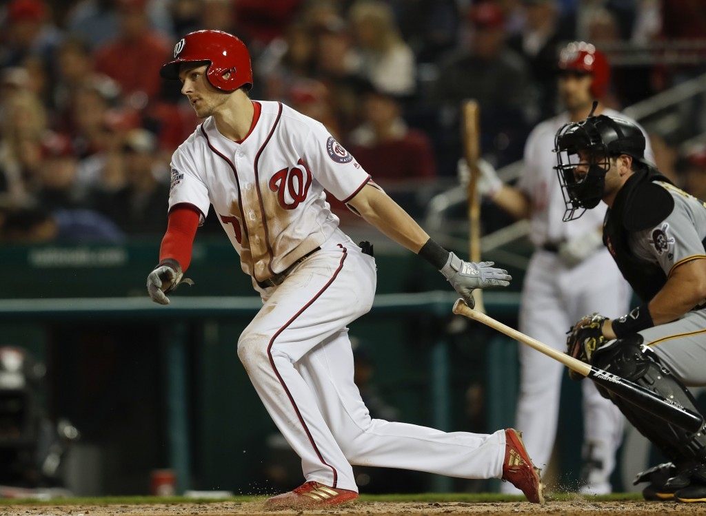 Washington Nationals' Trea Turner drops his bat as he hits an RBI-single off Pittsburgh Pirates starting pitcher Jameson Taillon during the fourth inn...