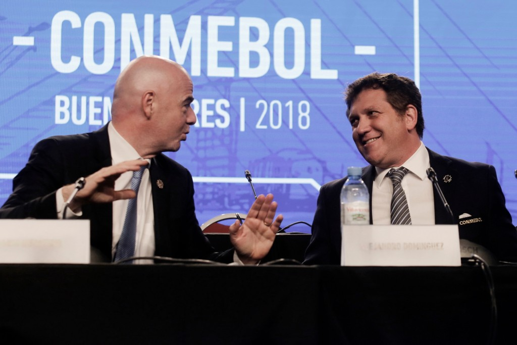 FILE - In this Thursday, April 12, 2018 file photo, FIFA President Gianni Infantino, left, talks with Alejandro Dominguez, right, president of the Sou...
