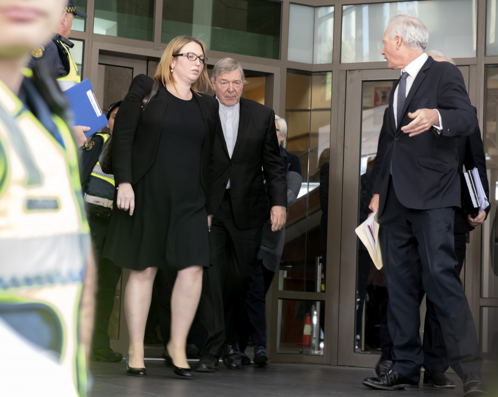 Australian Cardinal George Pell, center, leaves the Melbourne Magistrate Court in Melbourne Tuesday, May 1, 2018.  Australian Cardinal Pell, the most ...