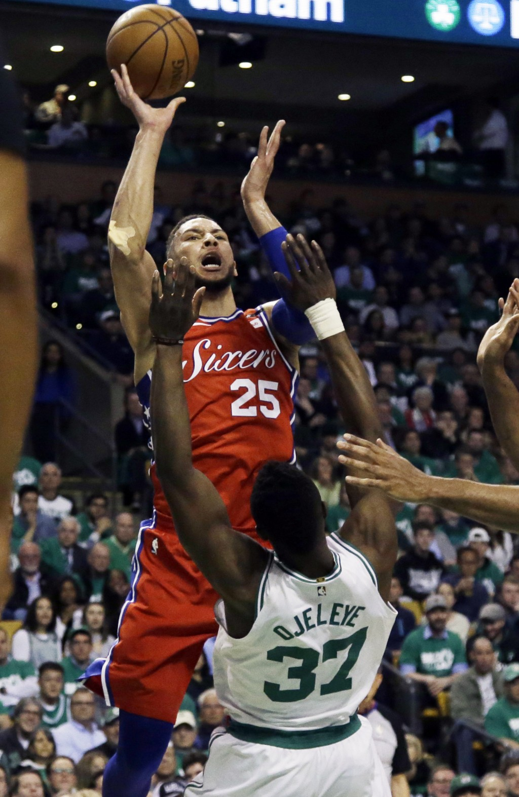 Philadelphia 76ers guard Ben Simmons (25) goes up for a shot and is called for a charge against Boston Celtics forward Semi Ojeleye (37) in the first ...
