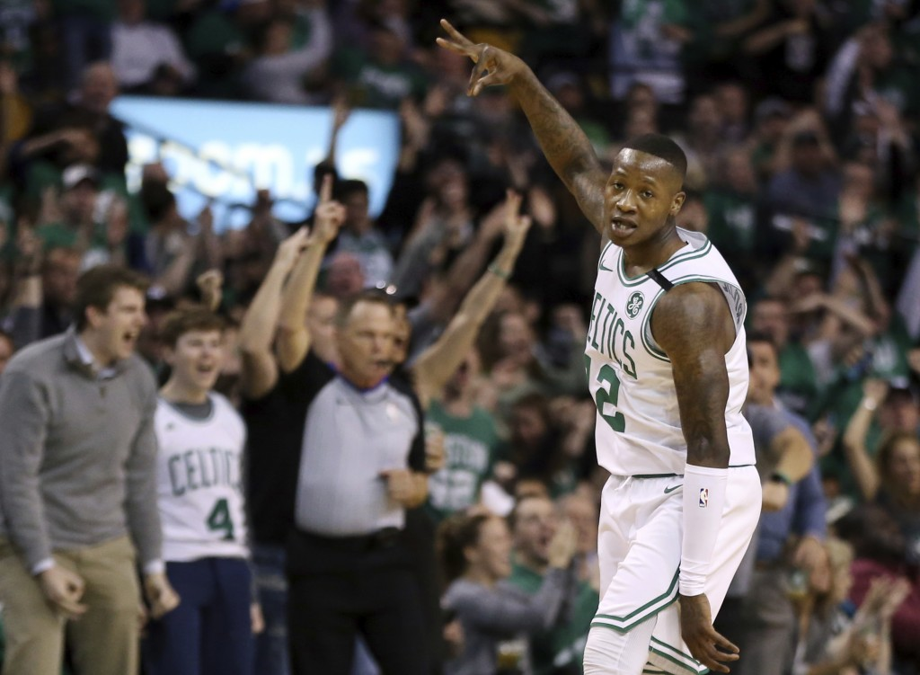 Boston Celtics guard Terry Rozier (12) celebrates his three-point shot against the Philadelphia 76ers in the first quarter of Game 1 of an NBA basketb...